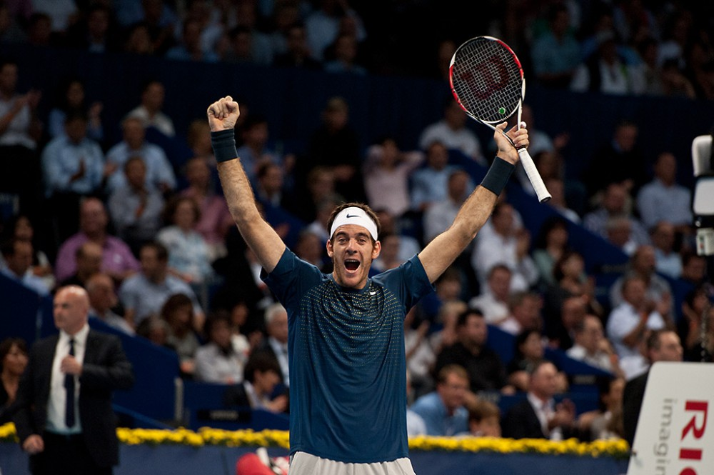 Basel, Switzerland. 27th Oct, 2013. J.M. Del Potro (ARG) raises his hands in the air after winning the final of the Swiss Indoors at St. Jakobshalle on Sunday.