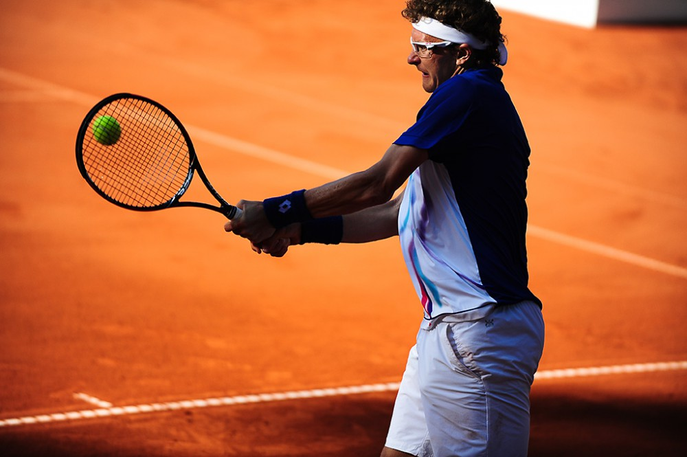 Duesseldorf, Germany. 23 May, 2014. Denis Istomin (UZB) returns the ball with a backhand during the semi final of the Duesseldorf Open at Rochusclub on Friday.