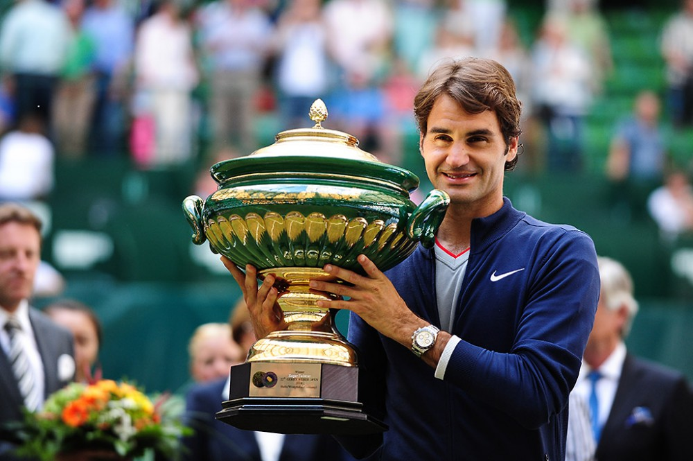 Halle (Westfalen), Germany. 15 June, 2014. 7 times Wimbledon champion Roger Federer wins his 7th title at the Gerry Weber Open defeating the world number 69 Alejandro Falla from Colombia 7:6 7:6.