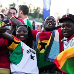 Ghana football fans celebrate as their team scores during a FIFA World Cup 2014 game between Germany and Ghana, broadcast at a large public viewing area in Freiburg, Germany. Final score 2-2 on June 21.