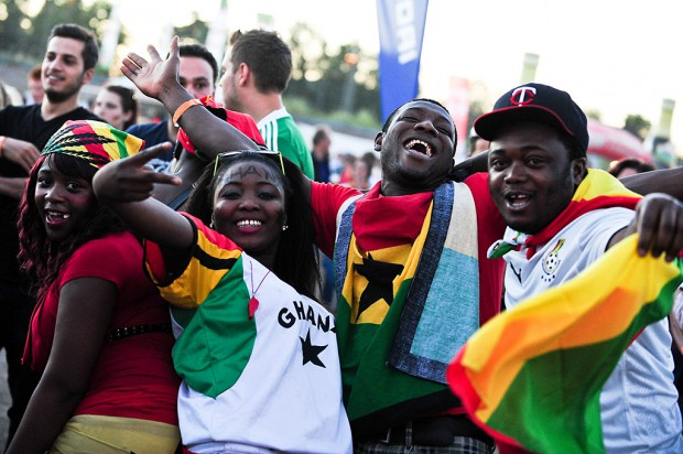 Freiburg, Germany. 21st June, 2014. Ghana football fans celebrate as their team scores during a FIFA World Cup 2014 game between Germany and Ghana, broadcast at a large public viewing area in Freiburg, Germany. Final score 2-2.
