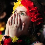 German shocked as she watches a FIFA World Cup 2014 game between Germany and Ghana at a large public viewing area in Freiburg, Germany. Final score 2-2 on June 21.