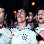 Thousands of football fans watch the FIFA World Cup 2014 game between Germany and Algeria, broadcast at a large public viewing area in Freiburg. Germany wins 2-1 on June 30.