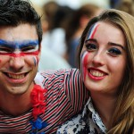 German and french football fans at a large public viewing area in Freiburg watch Germany advance to the semi finals of the FIFA World Cup 2014 after beating France 0-1 on July 4.