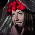 Happy German football fan with a rain cover at a large public viewing area in Freiburg watches Germany advance to the final of the FIFA World Cup 2014 after defeating the home favorite Brazil 7-1 on July 8.
