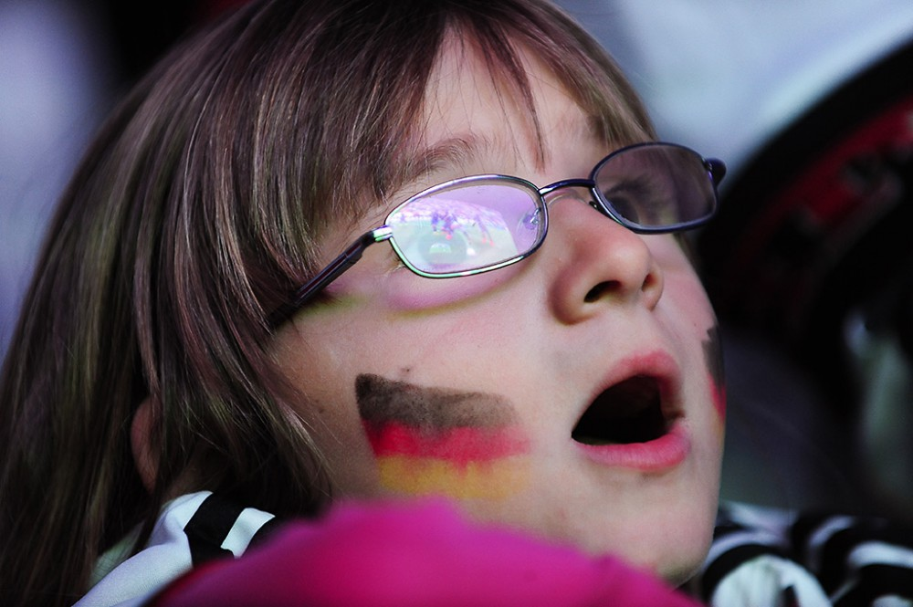 Freiburg, Germany. 13th July, 2014. Young football fan at a large public viewing area in Freiburg watches Germany play Argentina in the final of the FIFA World Cup 2014.