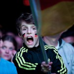 Young football fan at a large public viewing area in Freiburg waves a flag while watching Germany play Argentina in the final of the FIFA World Cup 2014 on July 13.