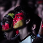 German football fan with colorfully painted face at a large public viewing area in Freiburg watches Germany play Argentina in the final of the FIFA World Cup 2014 on July 13.