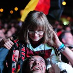 Football fans at a large public viewing area in Freiburg cheer after Germany wins the World Cup 2014, defeating Argentina 1-0 in the final on July 13.