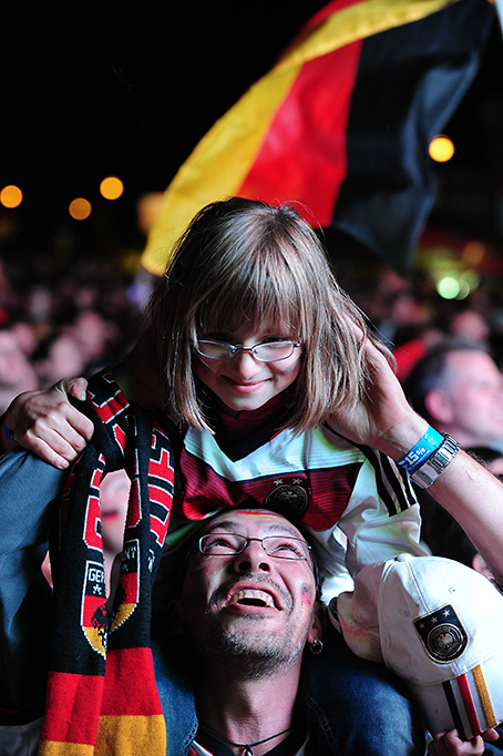 Freiburg, Germany. 13th July, 2014. Football fans at a large public viewing area in Freiburg cheer after Germany wins the World Cup 2014, defeating Argentina 1-0 in the final.