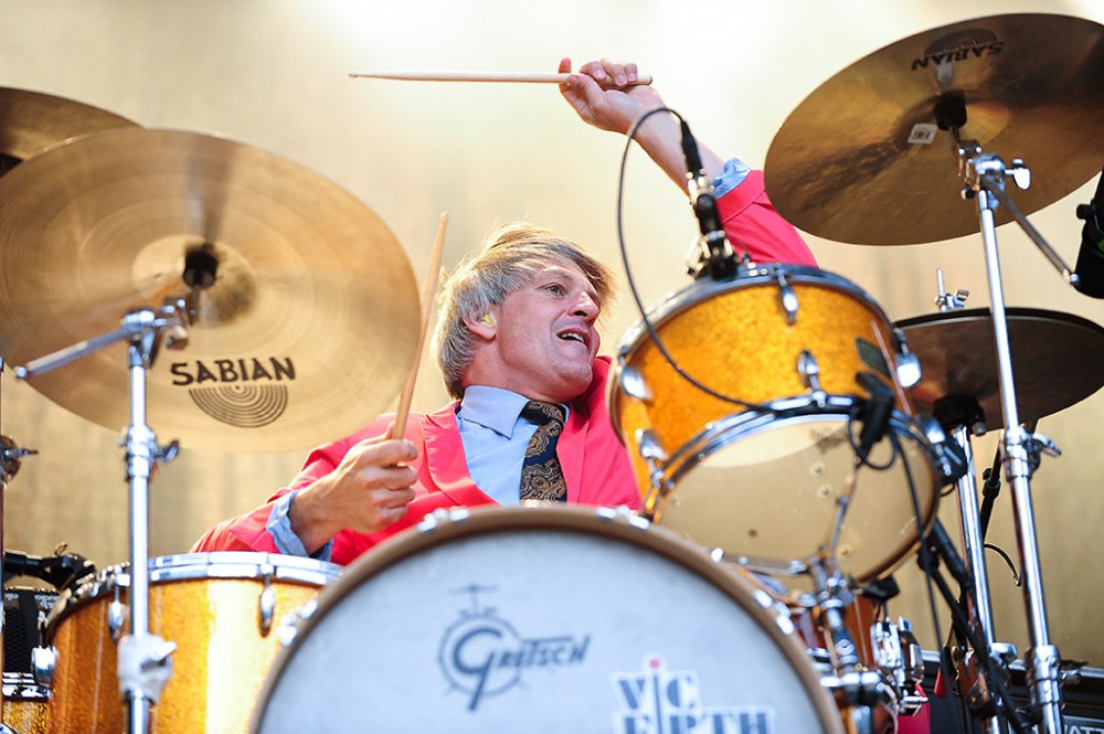 Lörrach, Germany.  26th July, 2014. Mario Goossens (drums) from Belgian rock band Triggerfinger, dressed in a pink suit, performs live at Stimmen (Voices) music festival in Lörrach, Germany.