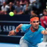 Rafael Nadal returns the ball with a forehand during a match of the 1st round of the Swiss Indoors at St. Jakobshalle in Basel, Switzerland on October 20, 2014.