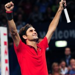 Basel, Switzerland. 26 October, 2014. Roger Federer raises hands after winning the Swiss Indoors title at St. Jakobshalle.