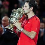 Basel, Switzerland. 26 October, 2014. Roger Federer kisses the Swiss Indoors trophy at St. Jakobshalle.