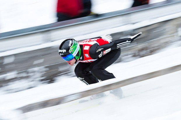 A competitor accelerates on the in-run during the Large Hill Individual competition on day two of the FIS Ski Jumping World Cup on February 8, 2015 in Titisee, Germany.